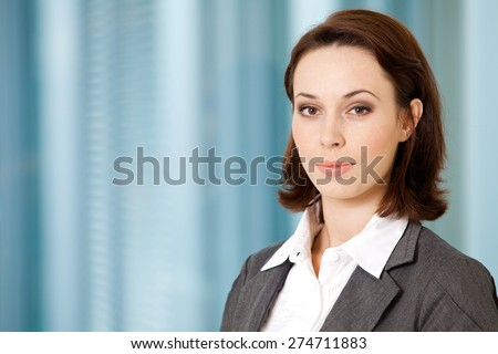 Portrait of young caucasian businesswoman in office - stock photo