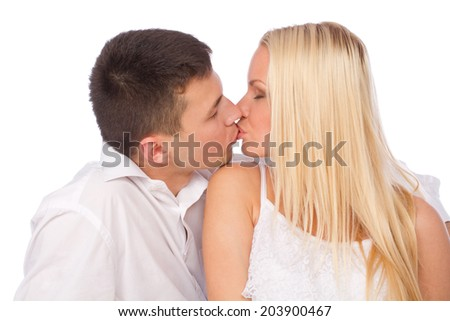 portrait of young caucasian couple kissing - stock photo