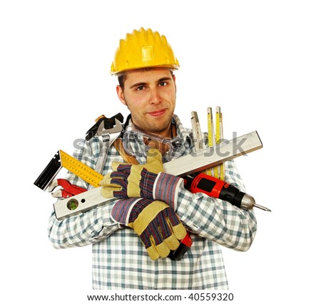 portrait of young caucasian handyman with lots of different tools - stock photo