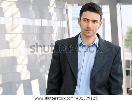 Portrait of young caucasian office worker. Suit no tie, copyspace. - stock photo