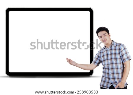 Portrait of young caucasian person showing empty copy space, isolated over white background - stock photo