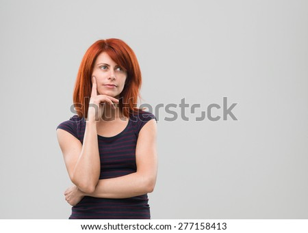 portrait of young caucasian woman with thinking gesture. copy space available - stock photo