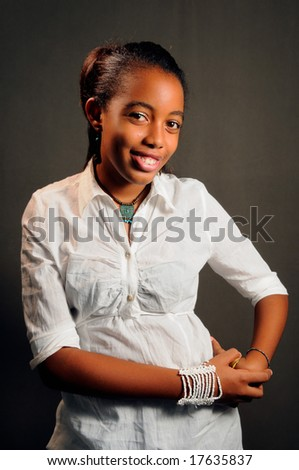 Portrait of young cheerful african teen girl posing - stock photo