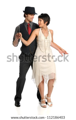 Portrait of young couple dancing isolated over white background - stock photo
