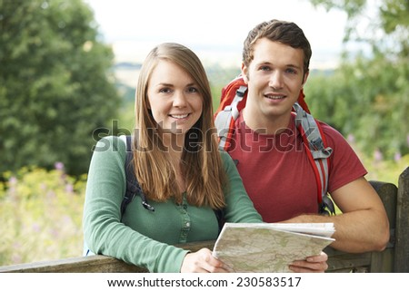 Portrait Of Young Couple Hiking In The Countryside - stock photo