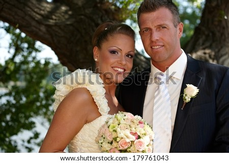 Portrait of young couple on wedding-day, smiling happy. - stock photo