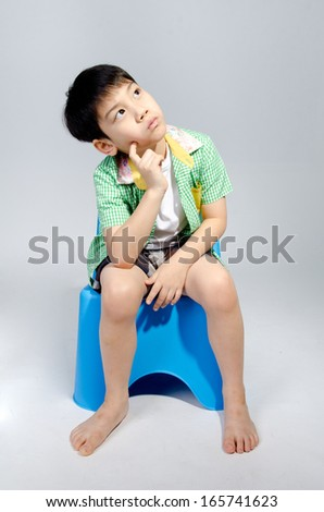 Portrait of young cute boy thinking.  - stock photo