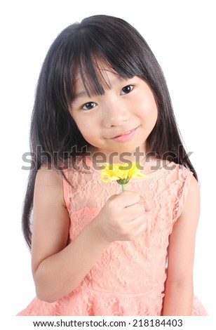 Portrait of young cute girl with yellow flower - stock photo