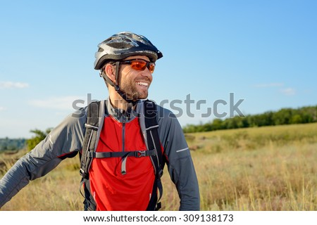 Portrait of Young Cyclist in Helmet and Glasses. Sport Lifestyle Concept. - stock photo