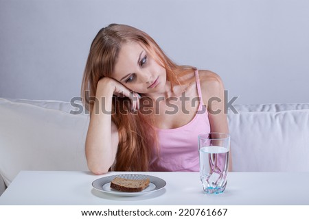 Portrait of young depressed girl with eating disorder - stock photo