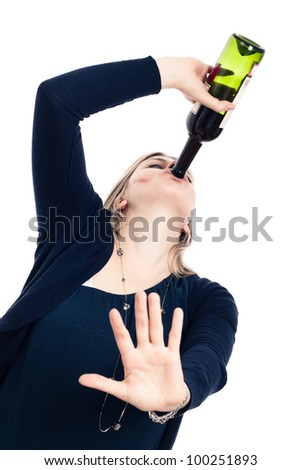 Portrait of young drunk woman drinking wine and gesturing stop, isolated on white background. - stock photo
