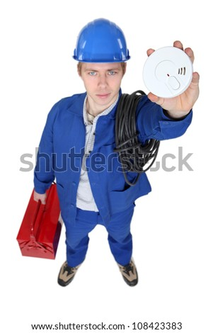 portrait of young electrician holding alarm - stock photo