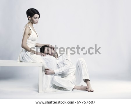 Portrait of young elegant couples in the tender passion - stock photo