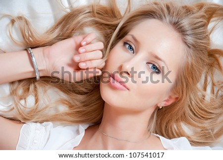 portrait of young elegant woman in bed - stock photo