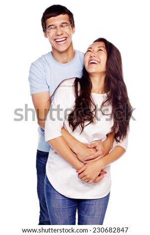 Portrait of young embracing couple isolated on white background - stock photo