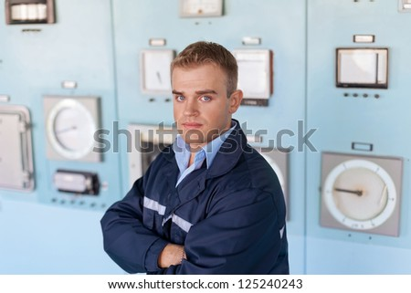 Portrait of young engineer at control room - stock photo