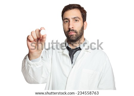 Portrait of young european doctor wit pill - stock photo