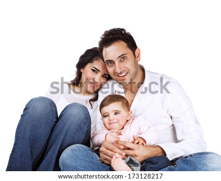Portrait of young family isolated on white background, cheerful parents with cute baby posing in the studio, togetherness concept - stock photo