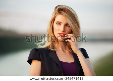 Portrait of young fashion woman at sunset - stock photo