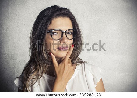 Portrait of young fashionable brunette woman with eyeglasses - stock photo
