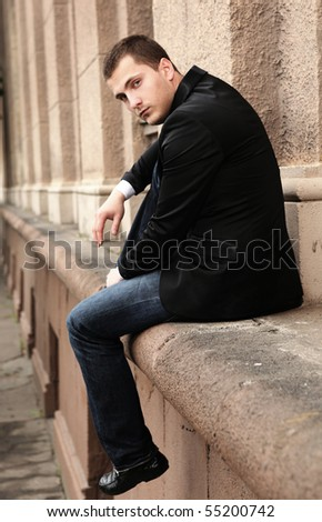 portrait of young fashionable businessman - stock photo