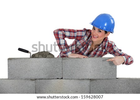 portrait of young female bricklayer - stock photo