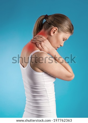 Portrait of young female in cotton underwear suffering from nape pain showing by red spot.  - stock photo