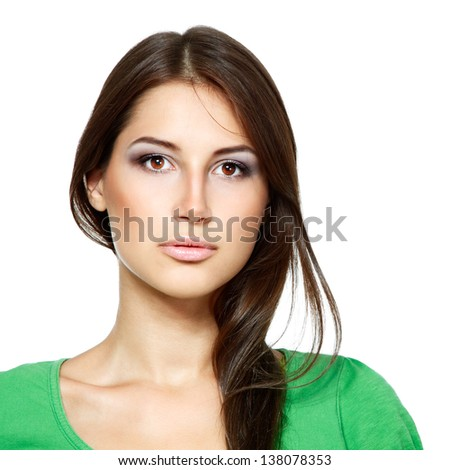 portrait of young fresh woman in green t-shirt looking at camera. Isolated on white background - stock photo