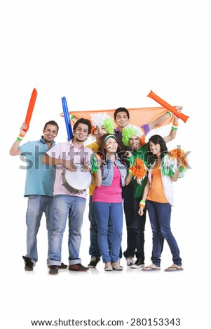 Portrait of young friends in casuals cheering with Indian flag over white background - stock photo