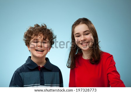 Portrait of young girl and boy - stock photo