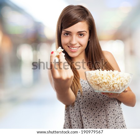 portrait of young girl eating pop corn - stock photo