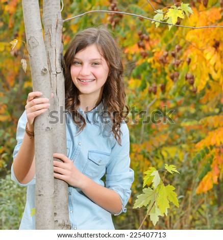 portrait of young girl in the autumn  park - stock photo