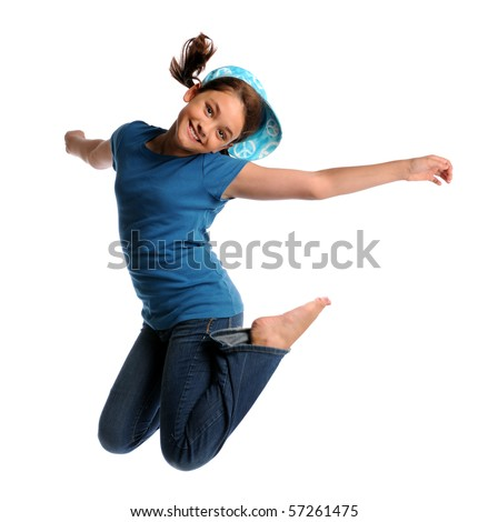 Portrait of young girl jumping isolated over white background - stock photo