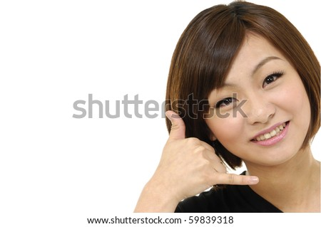 Portrait of young girl making a call me gesture - stock photo
