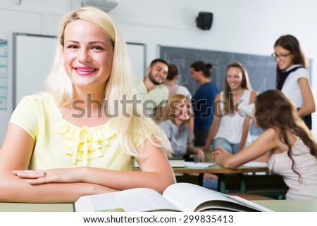 Portrait of young girl paying attention in class during lesson - stock photo