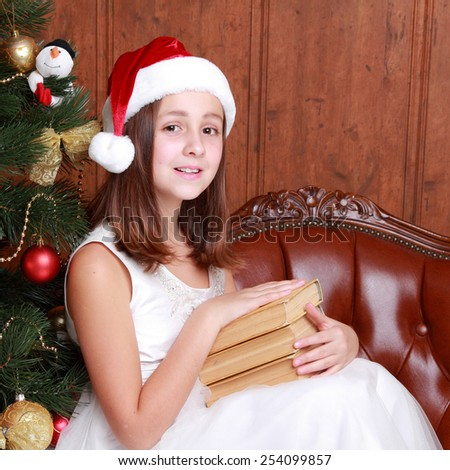 Portrait of young girl wearing cute santa hat on Holiday theme - stock photo