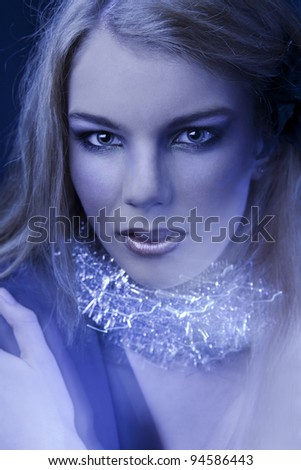 Portrait of young girl with bright make-up.fashion art.magic blue light. - stock photo