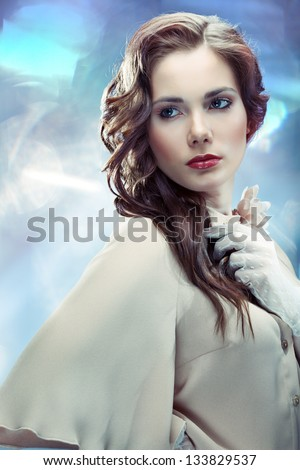 Portrait of young glamourous woman on sparkling background in old Hollywood style - stock photo