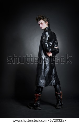 portrait of young goth that looking at camera - stock photo