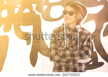 portrait of young guy  with rasta hair in a lifestyle concept warm filter applied - stock photo