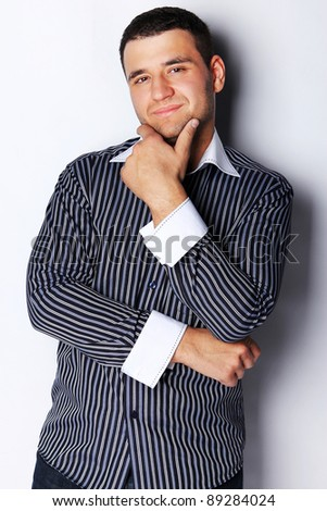 Portrait of young handsome male posing - stock photo