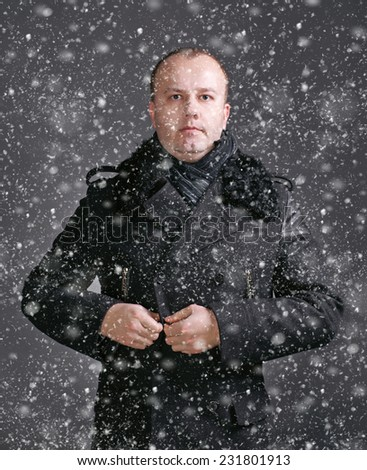 Portrait of young handsome man wearing winter coat.  Christmas and holidays concept - stock photo