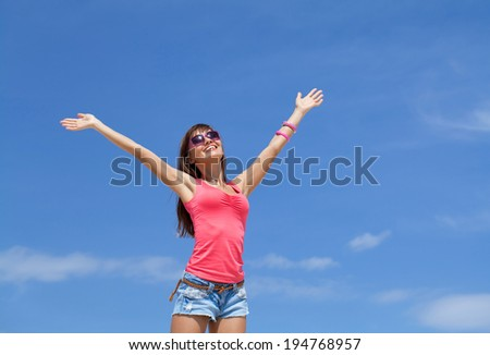 Portrait of young happiness woman in summer time - stock photo