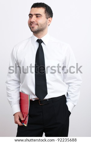 Portrait of young happy businessman in white shirt and black tie - stock photo