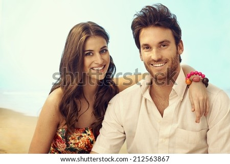 Portrait of young happy casual caucasian couple on vacation. Attractive woman and handsome man, smiling, looking at camera, outdoor, copyspace. - stock photo