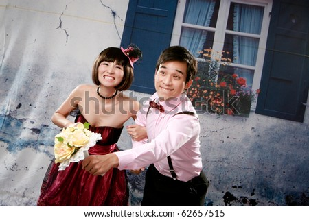 Portrait of young happy couple in lovely action - stock photo