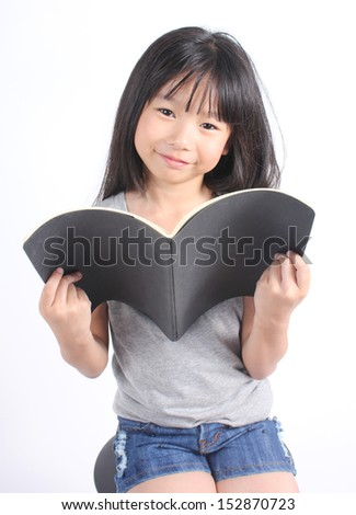 Portrait of young happy girl with book  - stock photo