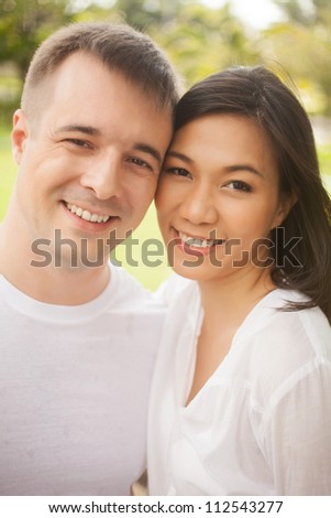 Portrait of young happy lovers - stock photo