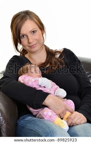 Portrait of young happy mother with newborn baby isolated on white background - stock photo
