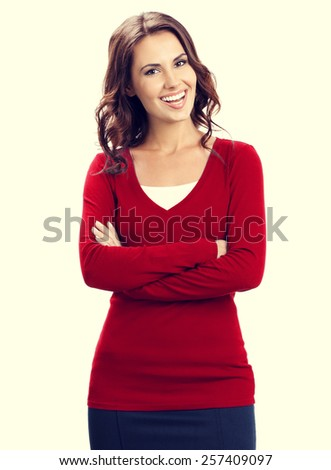 Portrait of young happy smiling beautiful business woman in red - stock photo